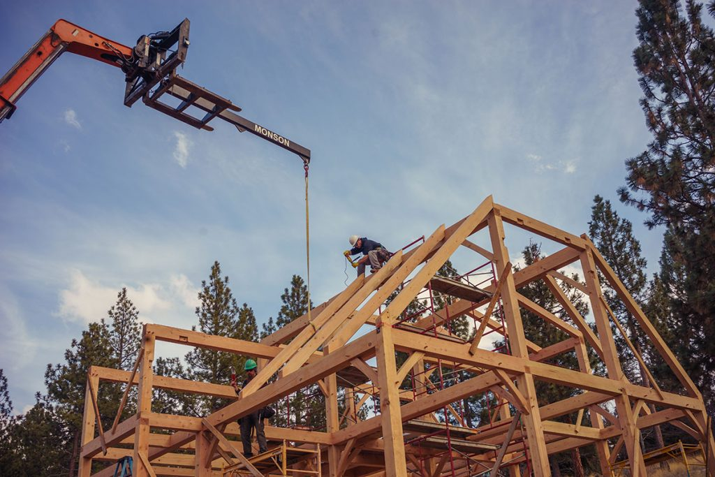 using the crane to get the timber frame together